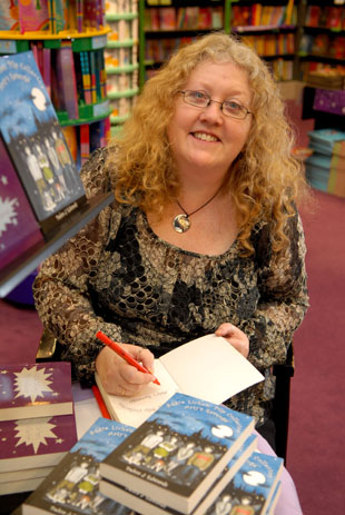 Children's author Debbie Edwards signing books in Sutton