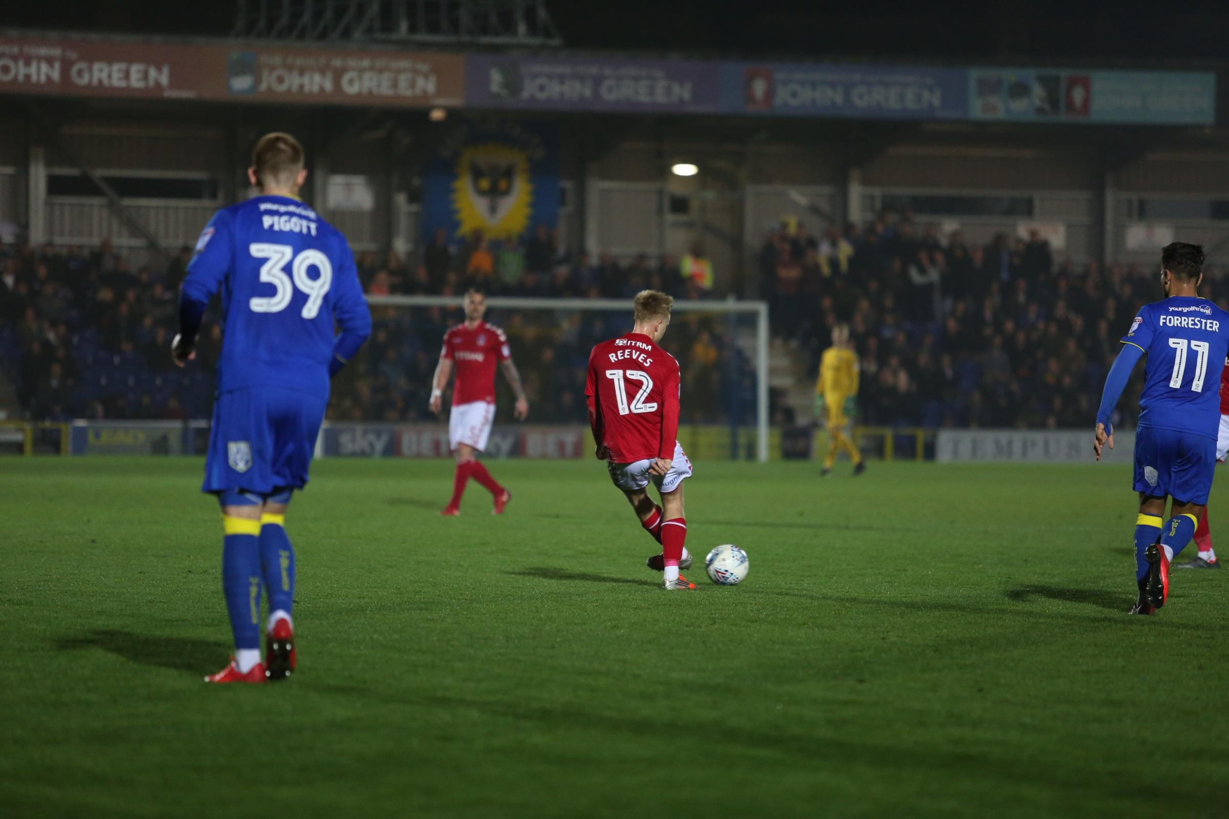 AFC Wimbledon striker Joe Pigott looks on after a Ben Reeves pass | Picture: Tom West Photography