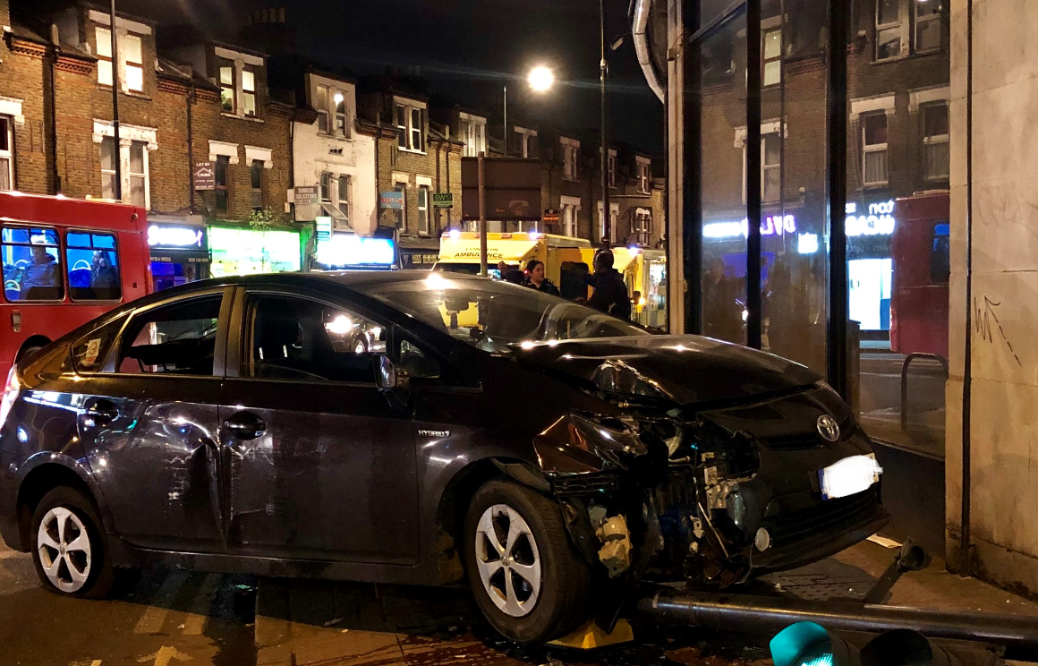 car crashes outside South Wimbledon tube station into a traffic light. Picture credit: Janet Snell
