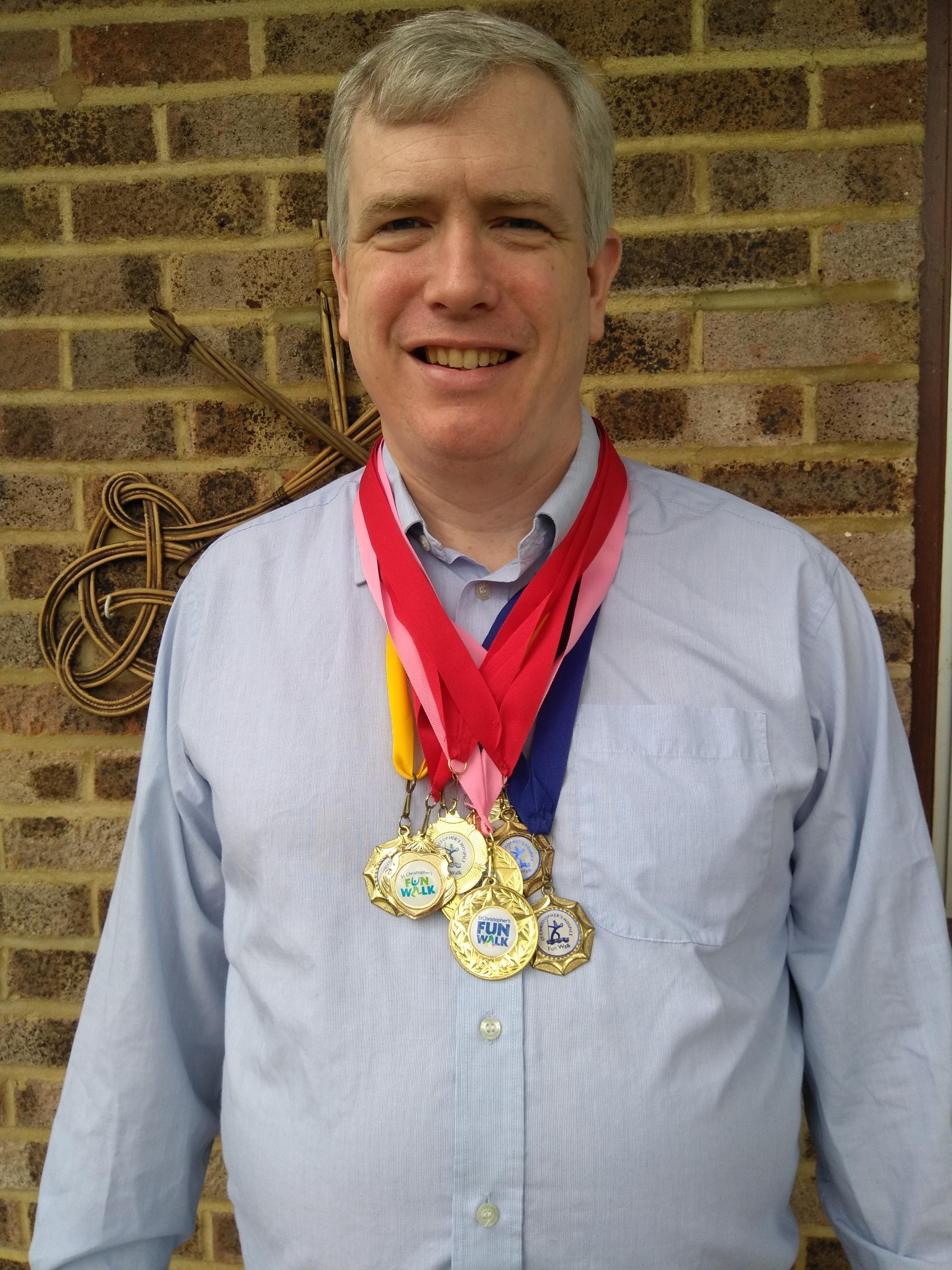 Nigel Callow with his medals