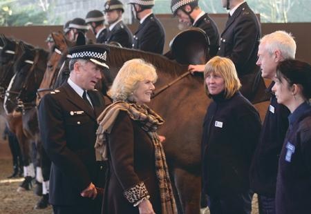 Camilla showed her affection for animals as she smiled and fed the horses polo mints.