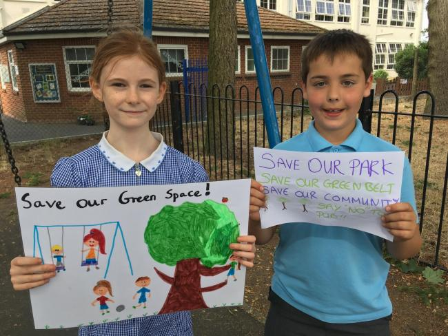 Poppy Buchanan, 9,  and Adam Gardner, 10, are among those campaigning to Save West Byfleet Recreation Ground in Surrey. Credit LDR. Cleared for use
