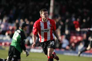Top class:  Brentford's Charlie MacDonald celebrates during Saturday's 3-0 win over Chester City.