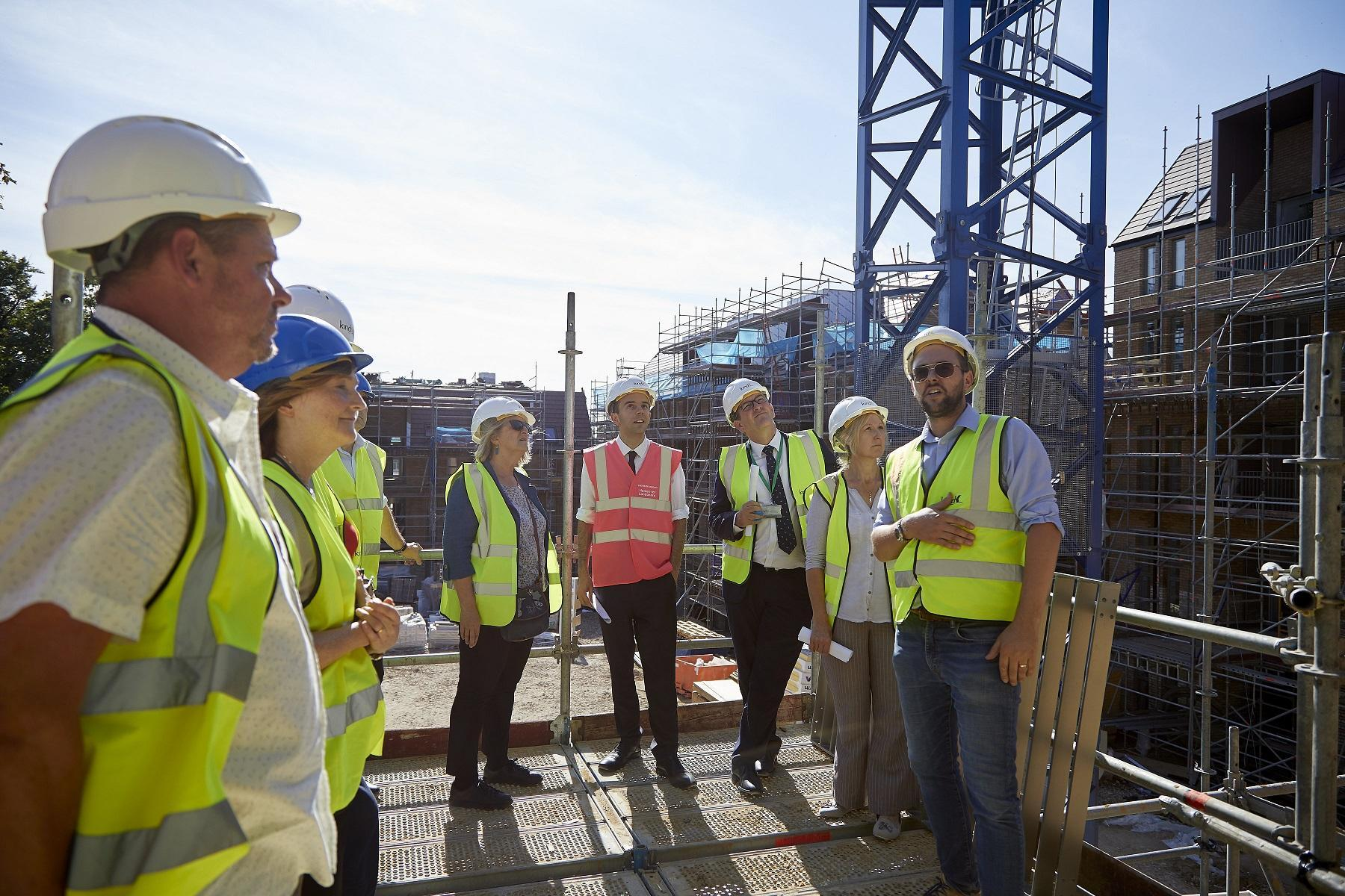 Deputy Mayor for Housing and Residential Development James Murray in the red high-vis jacket