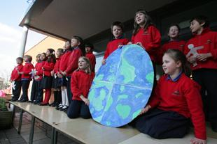 Marshgate Primary School pupils celebrate the launch of their solar energy project