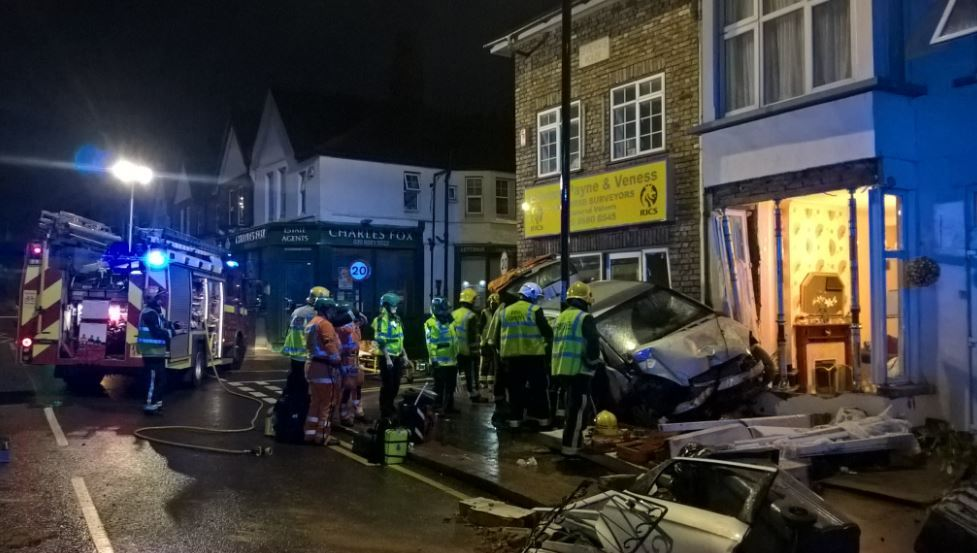 Firefighters freed a man who was trapped in a vehicle after a crash in South Croydon