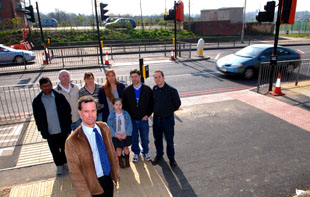 Councillor Dave Callaghan with residents by the crossing which requires a detour