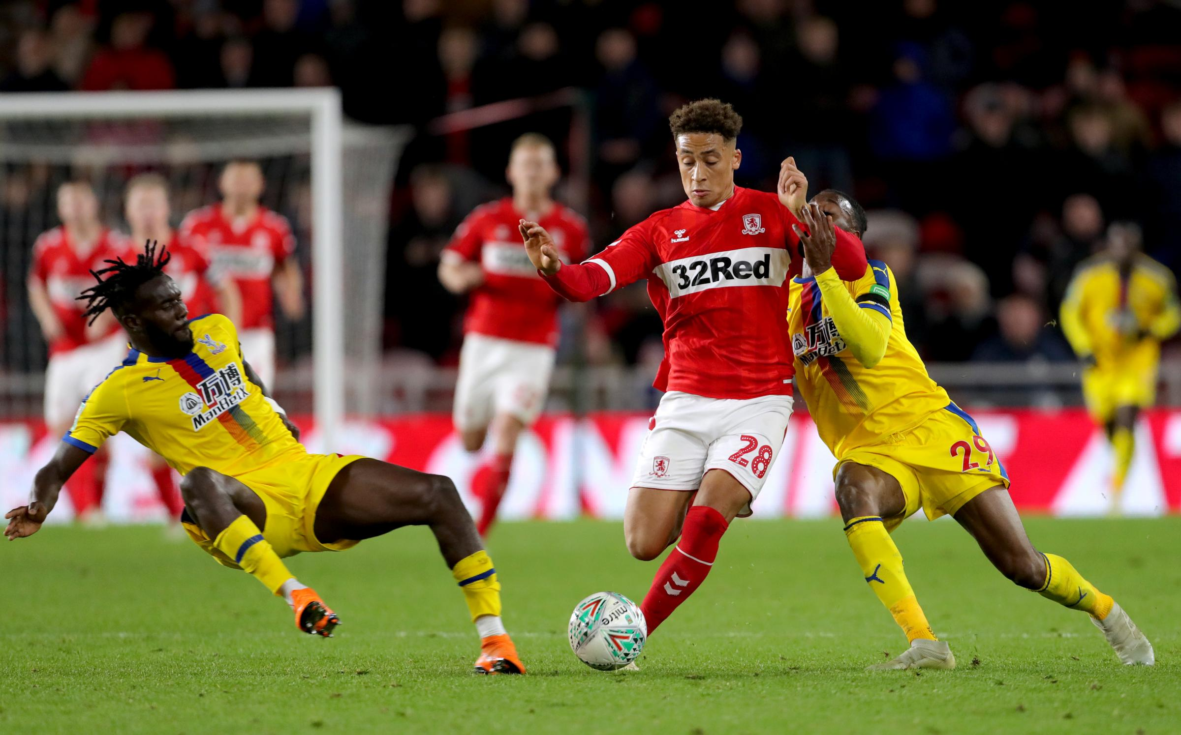 Middlesbrough's Marcus Tavernier (centre) battles for the ball with Crystal Palace's Aaron Wan-Bissaka (right) and Pape Souare (pic: Richard Sellers/PA Wire/PA Images)