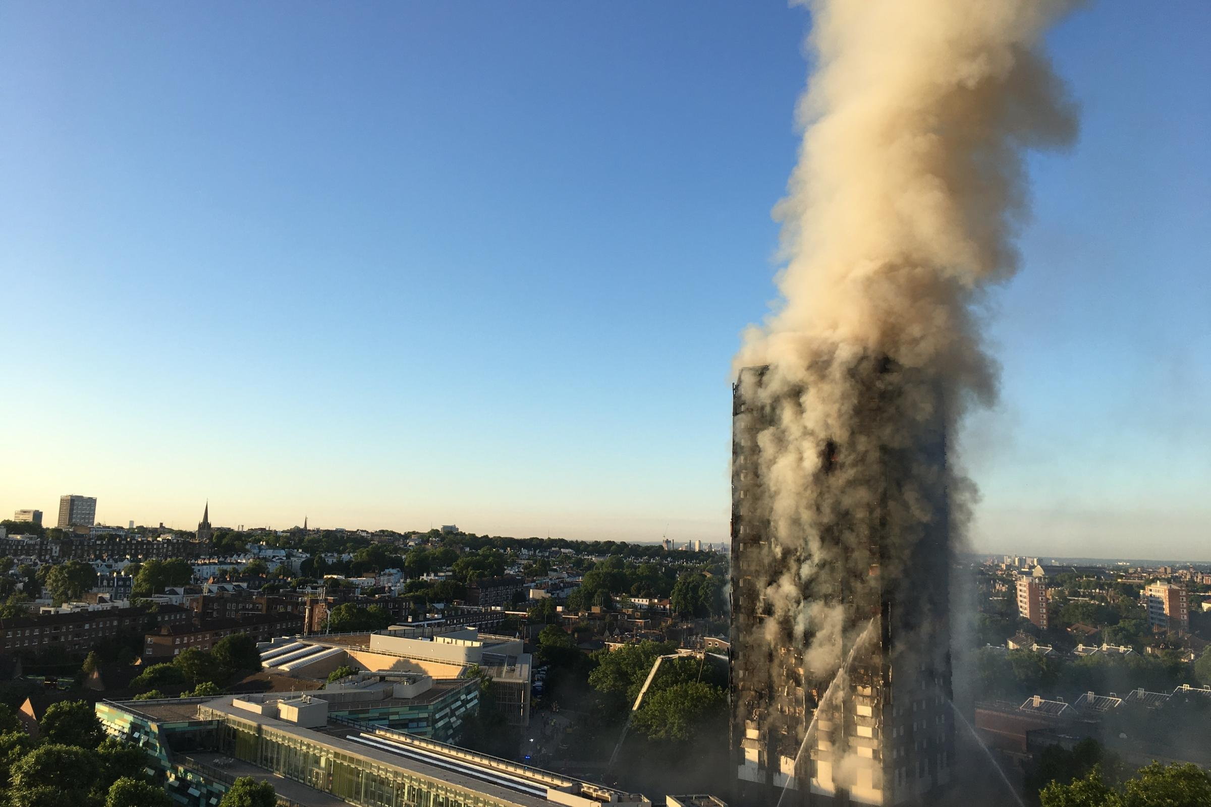 Smoke pours from the fire at Grenfell Tower