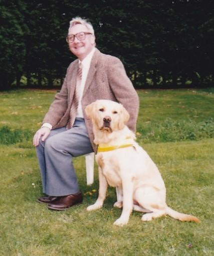 Chris Gilroy with one of his guide dogs, Bailey