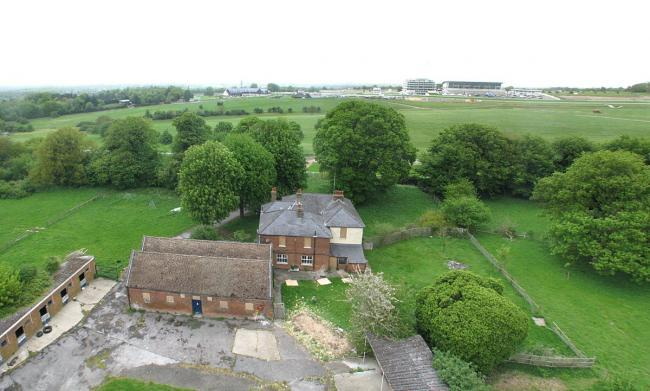 Decision expected today on redevelopment of historic horse training yard Downs House