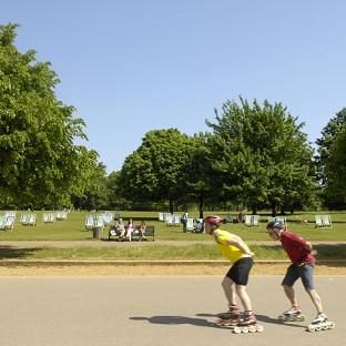 Your Local Guardian: Rollerbladers enjoy the sun in Hyde Park, London
