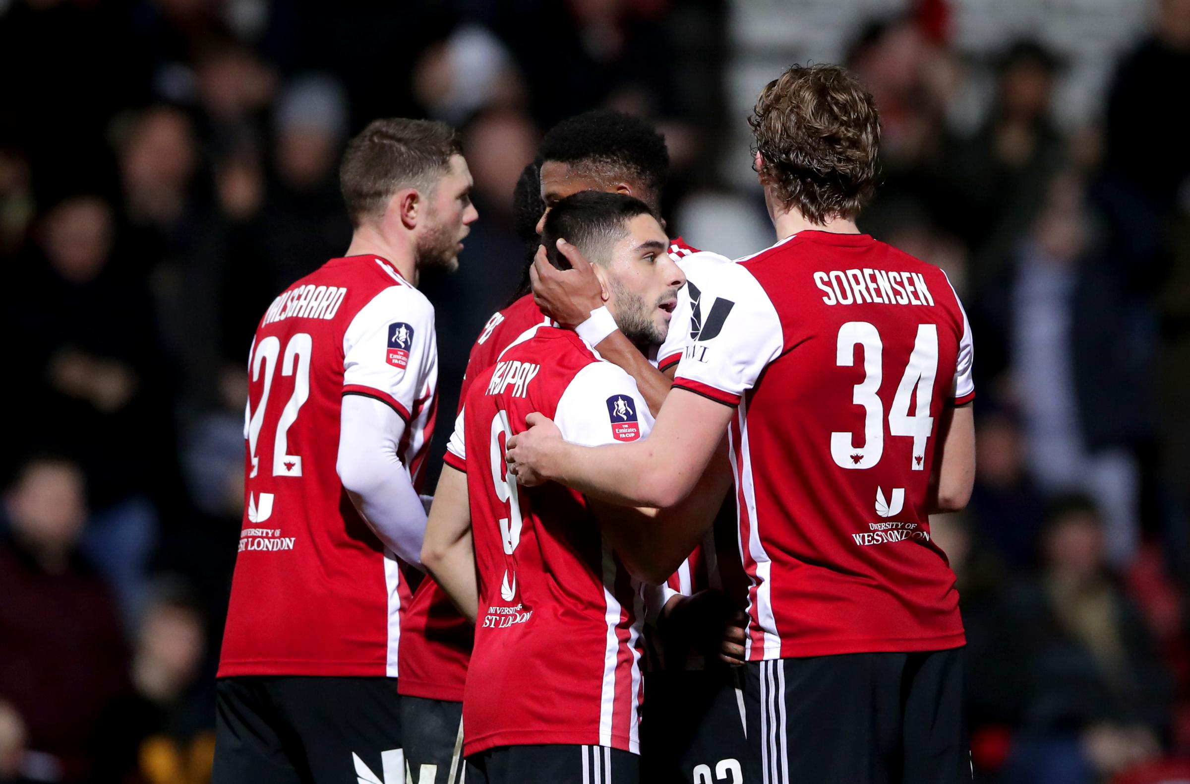 Brentford's Neal Maupay (centre) celebrates scoring his side's third goal of the game with his team mates during the FA Cup fourth round replay match at Griffin Park, London. (PA)