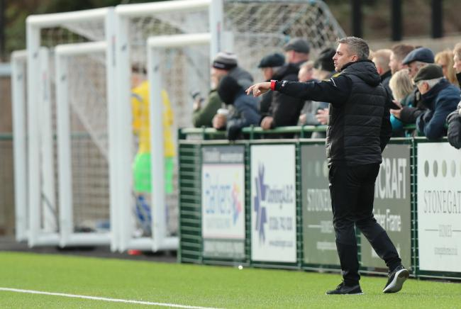 Leigh Dynan watches his side lose 7-1 at Dorking Wanderers. Pic: Simon Roe