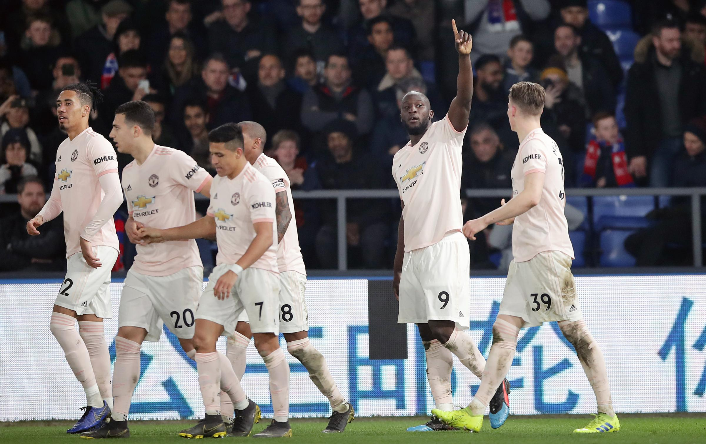 Manchester United's Romelu Lukaku (second right) celebrates scoring his side's second goal of the game during the Premier League match at Selhurst Park, London.(Photo credit: John Walton/PA Wire.)