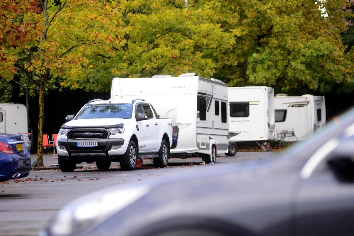 Group of travellers set up at Sainsbury's carpark in Hampton