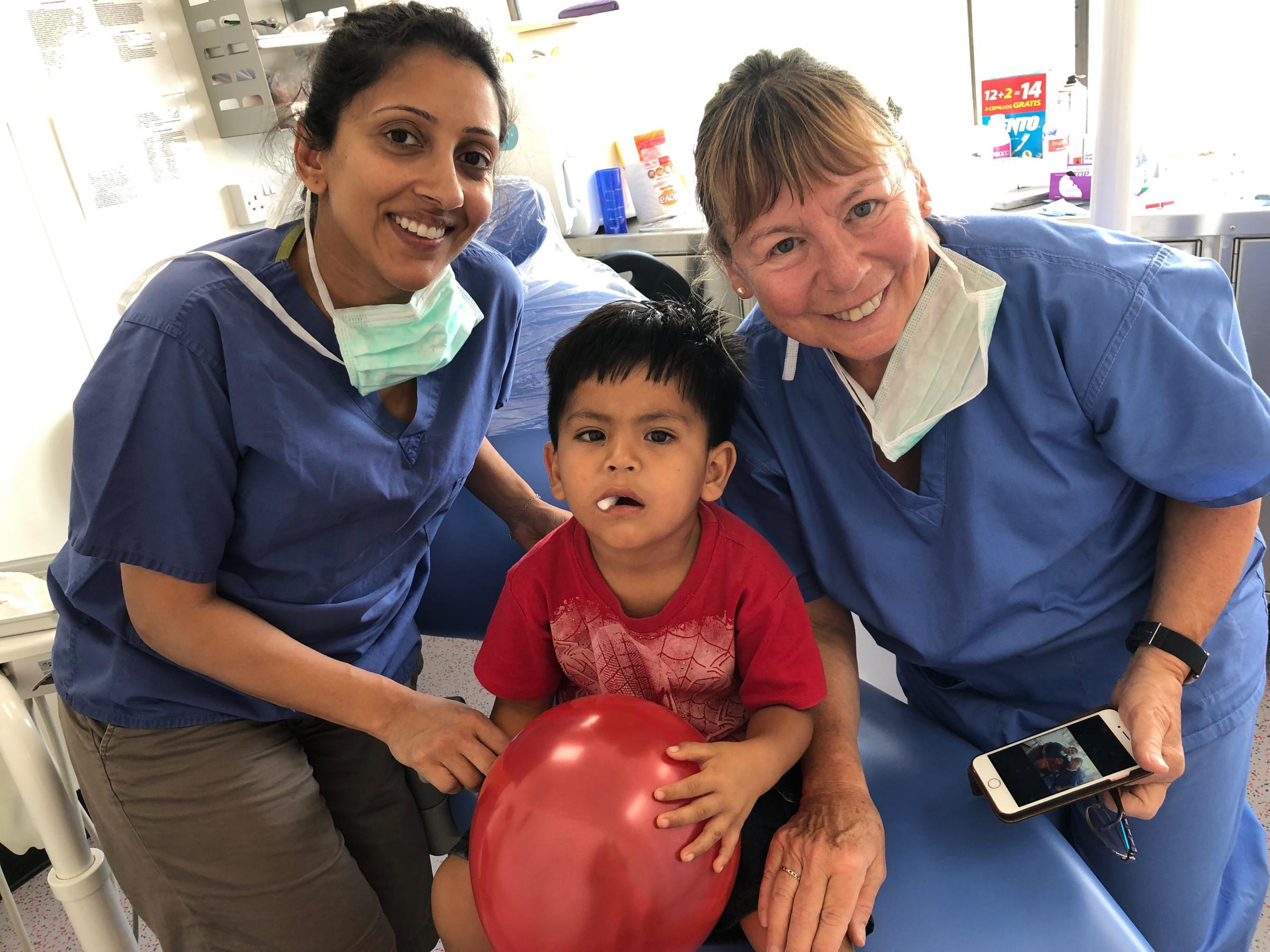 Deepali Patel with a patient and another volunteer