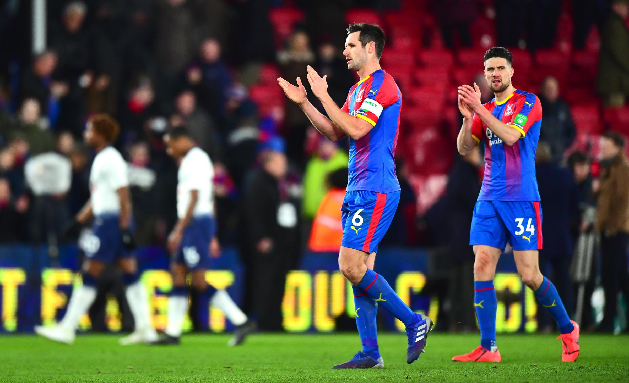 Crystal Palace's Martin Kelly (right) and Scott Dann celebrate victory after the FA Cup fourth round match at Selhurst Park, London.