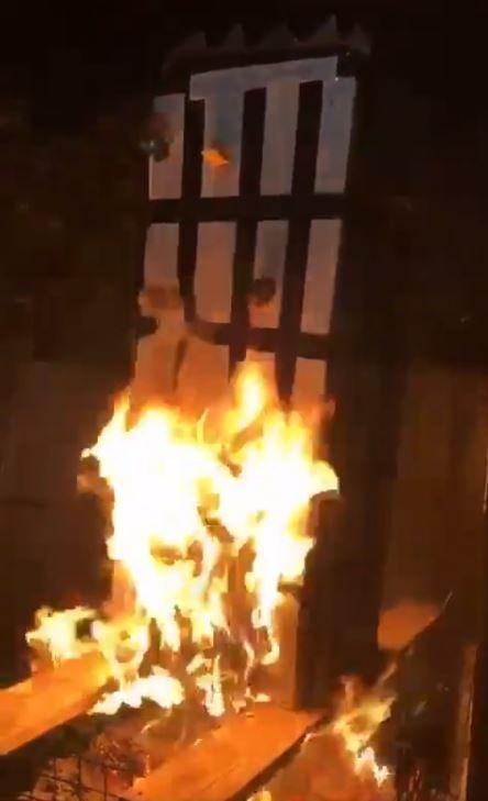 A still from the video showing the burning tower