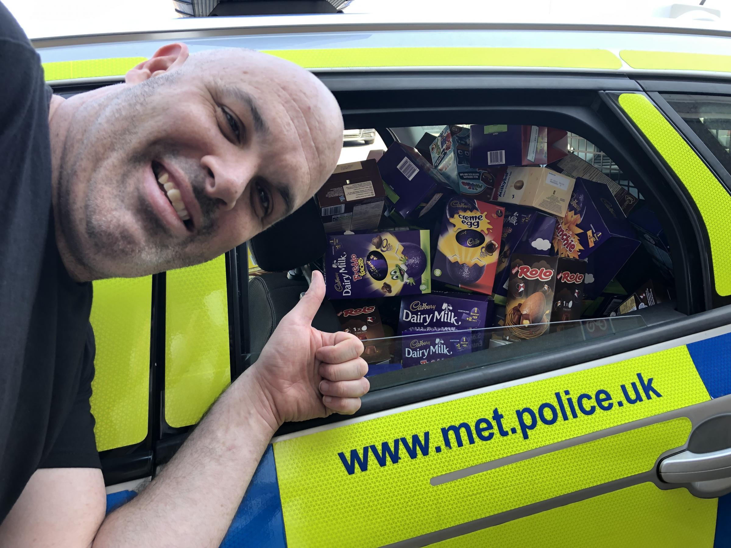 Constable Hamilton with the car full of Easter eggs