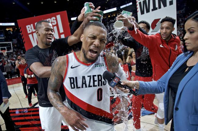 Portland Trail Blazers' Damian Lillard celebrates his series winner