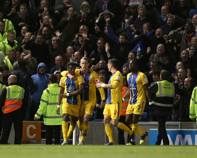 Crystal Palace's Wilfried Zaha (left) celebrates in front of his team's fans after scoring his team's opening goal