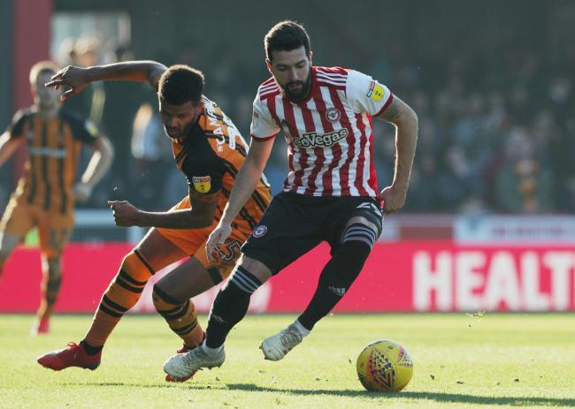 Brentford's Yoann Barbet (right) holds off Hull City's Fraizer Campbell (left) during the Sky Bet Championship match at Griffin Park, London. PRESS ASSOCIATION Photo. Picture date: Saturday February 23, 2019. See PA story SOCCER Brentford. Photo c