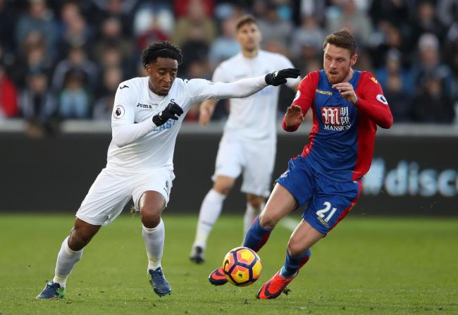 Swansea City's Leroy Fer (left) and Crystal Palace's Connor Wickham battle for the ball