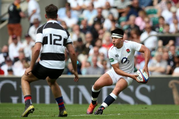 LONDON, ENGLAND - JUNE 02: Marcus Smith of England (L) offloads the ball during the Quilter Cup match between England and Barbarians at Twickenham Stadium on June 02, 2019 in London, England. (Photo by Steve Bardens - RFU/The RFU Collection via Getty Imag
